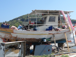 Image of a disorganized, dry docked boat